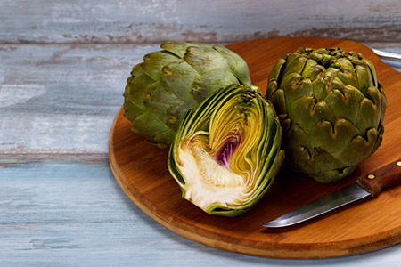 Cut artichokes on a serving plate
