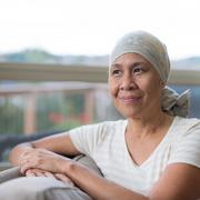 Cancer patient looking out a window and smiling