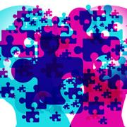 Digital illustration of two opposite-facing heads with puzzle pieces