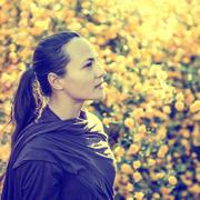 Peaceful woman in a field looking up with positive emotion